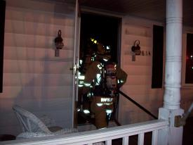 Early Morning Dwelling Fire on Bird View Rd. Crews enter the front door to check for hot spots on both floors.
