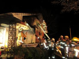Firefighters check for extension of the fire in the ceiling and roof.