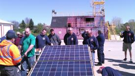 Firefighters examine the solar panel prop at the Carroll County Public Safety Training Center.