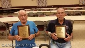 Charter members Kenny Linton (l) and Charlie Arnold at the July company meeting with their MSFA plaques.  Photo by R. Panos