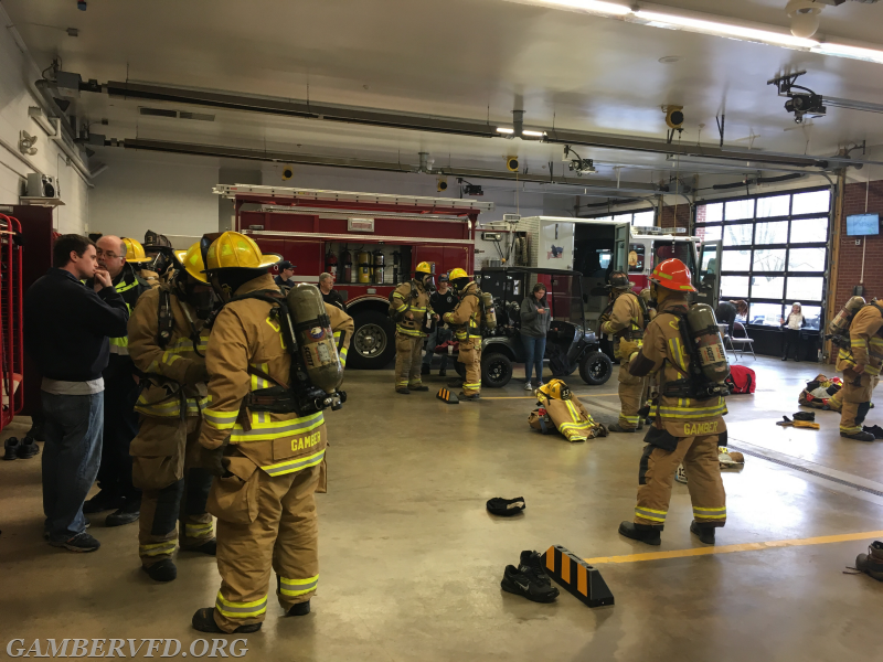 Gamber members in full turnout gear refresh their SCBA skills.