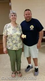 Rose Pandolfini (l) was awarded her Life Active Membership by President Mike Franklin at the April company meeting.