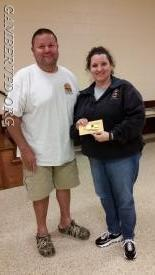 Bridget Weishaar (l) was awarded her Life Active Membership by President Mike Franklin at the May company meeting.