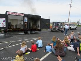 Families watch the fire start in the right hand side of the trailer which is the unsprinklered side.