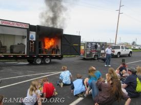 The fire grows faster as it consumes the furnishings in the unsprinklered side of the Side-By-Side demonstration trailer.