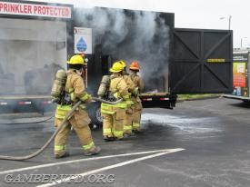Gamber firefighters extinguish the fire in the unsprinklered side of the trailer.