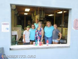 Gamber Auxiliary members and their families serve beverages.