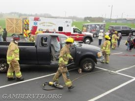 Firefighters from Gamber conduct a vehicle extrication demonstration.
