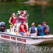 Boat 13 returning to shore with the three victims from the overturned canoe. photo credit - Mike Jordan/mpjordan.com