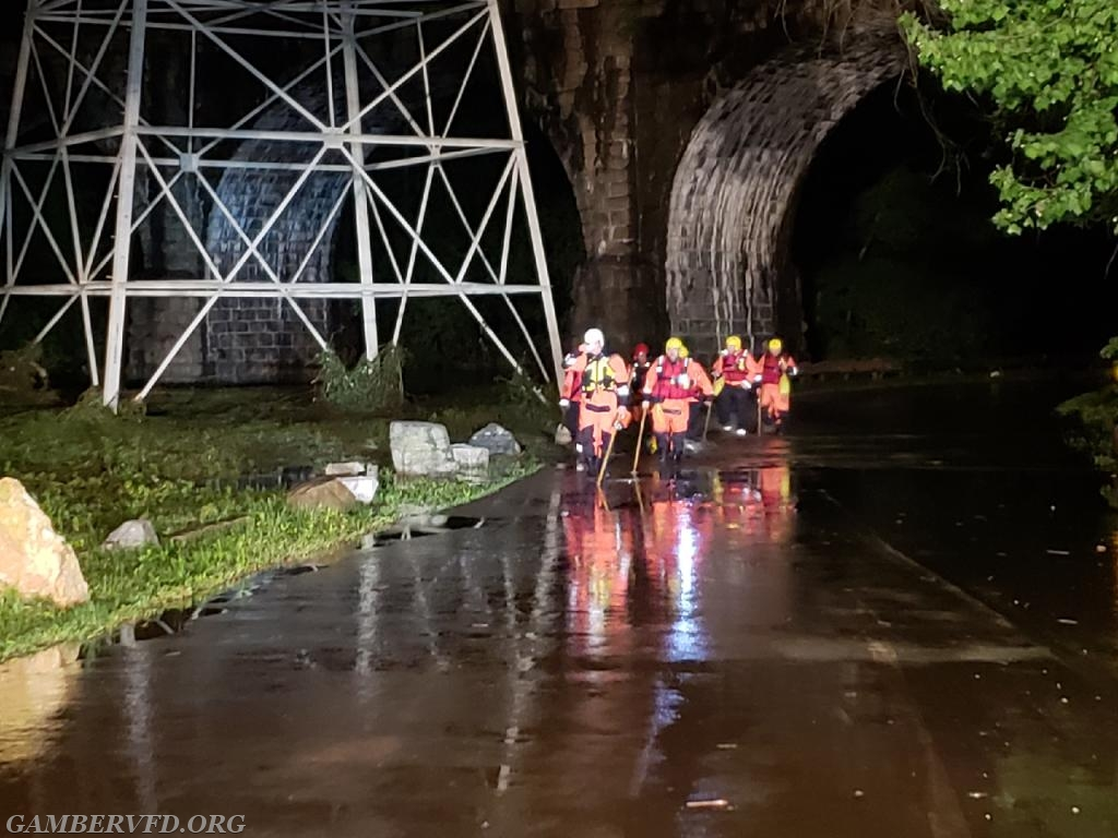Team members returning from searching for possible victims swept away during the flash flooding in the Avalon section of Patapsco State Park, Howard County.