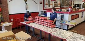 Dexter was following the video guidelines provided from Firehouse Subs for getting 25 boxes to fit perfectly in each box.