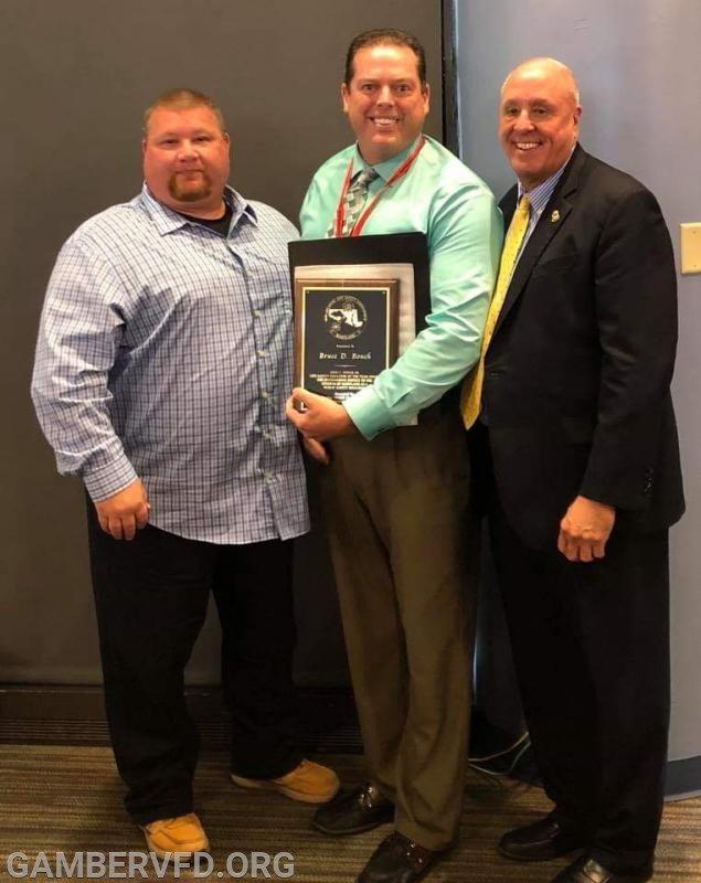 THE 2018 JOHN C. SPIKER, SR. EXCELLENCE IN LIFE SAFETY EDUCATOR OF THE YEAR AWARD winner, Bruce Bouch, center. Presenting the award is John Spiker, Jr. (l) and Maryland  State Fire Marshal Brian S. Geraci (r)