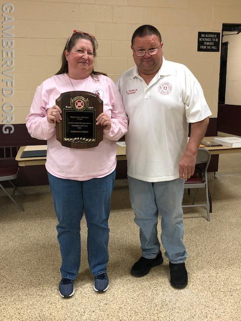 President Mike Franklin (r) presents  Chrissy Green with the Herman Hoff Memorial Award for outstanding service in fund raising.
