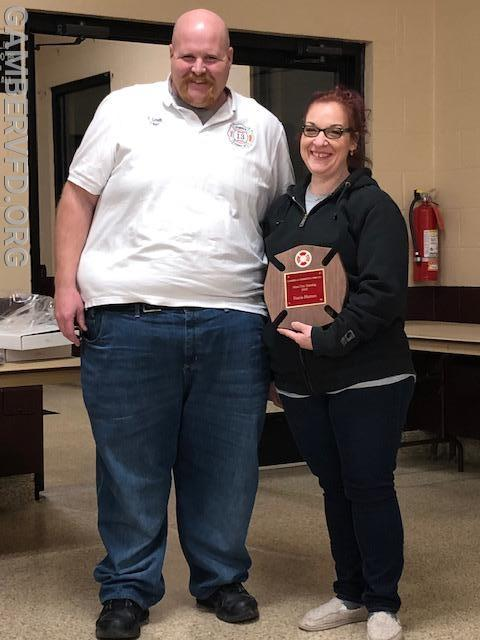 Chief Charlie Green (l) presents Firefighter Stacia Hutton with a plaque recognizing her for the most training hours for 2018.