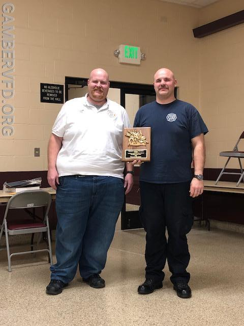 Chief Charlie Green (l) presents the Gerald L. Lindsay Memorial Firefighter of the Year Award to Firefighter William Reardon.