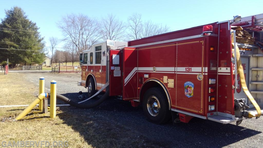 Engine 131 set up to draft water from the Buc's Club pond on Bird View Road.