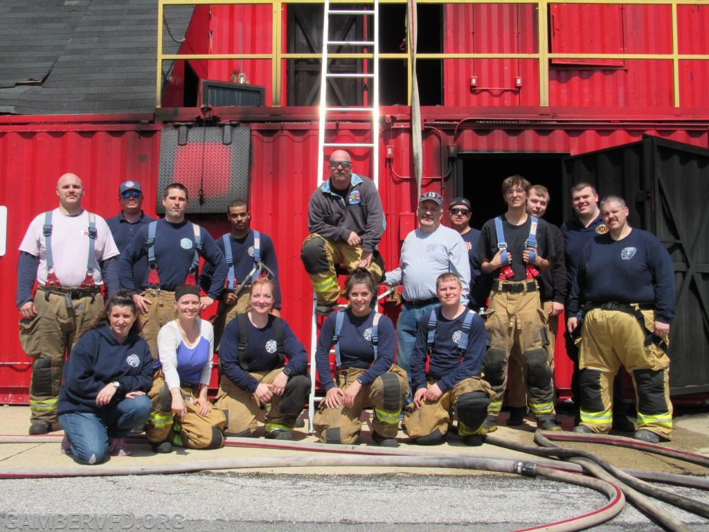 Saturday morning training participants pose in front of the burn building after the drills. Photo by Jacob Smith