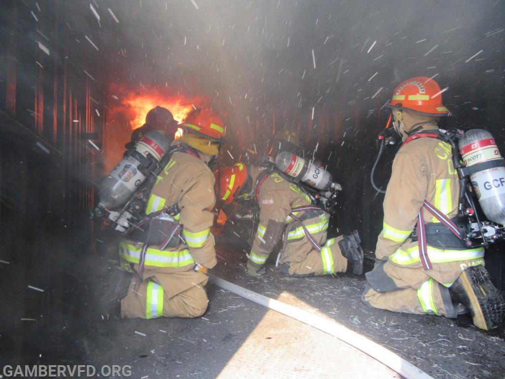 Observing fire behavior inside the burn building.