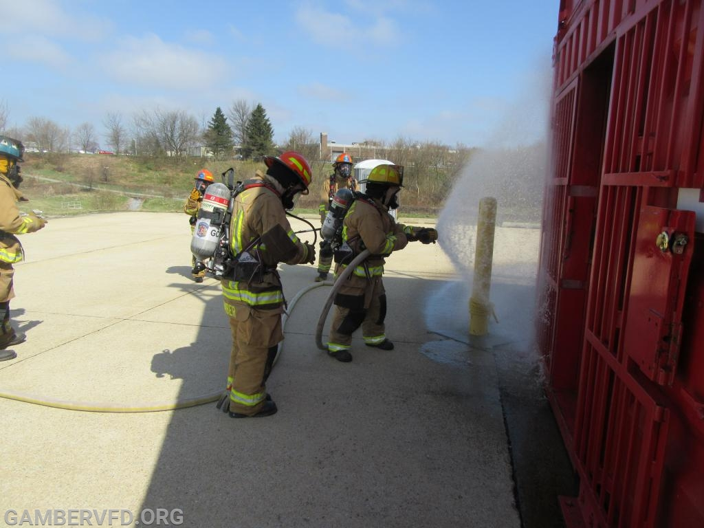 Preparing to advance a hose line into the building.