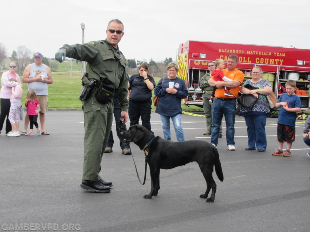 "Senior Deputy State Fire Marshal Oliver Alkire and his K-9 partner ""Kachina"" prepare to conduct a demonstration. The K-9 is trained to search for accelerants."