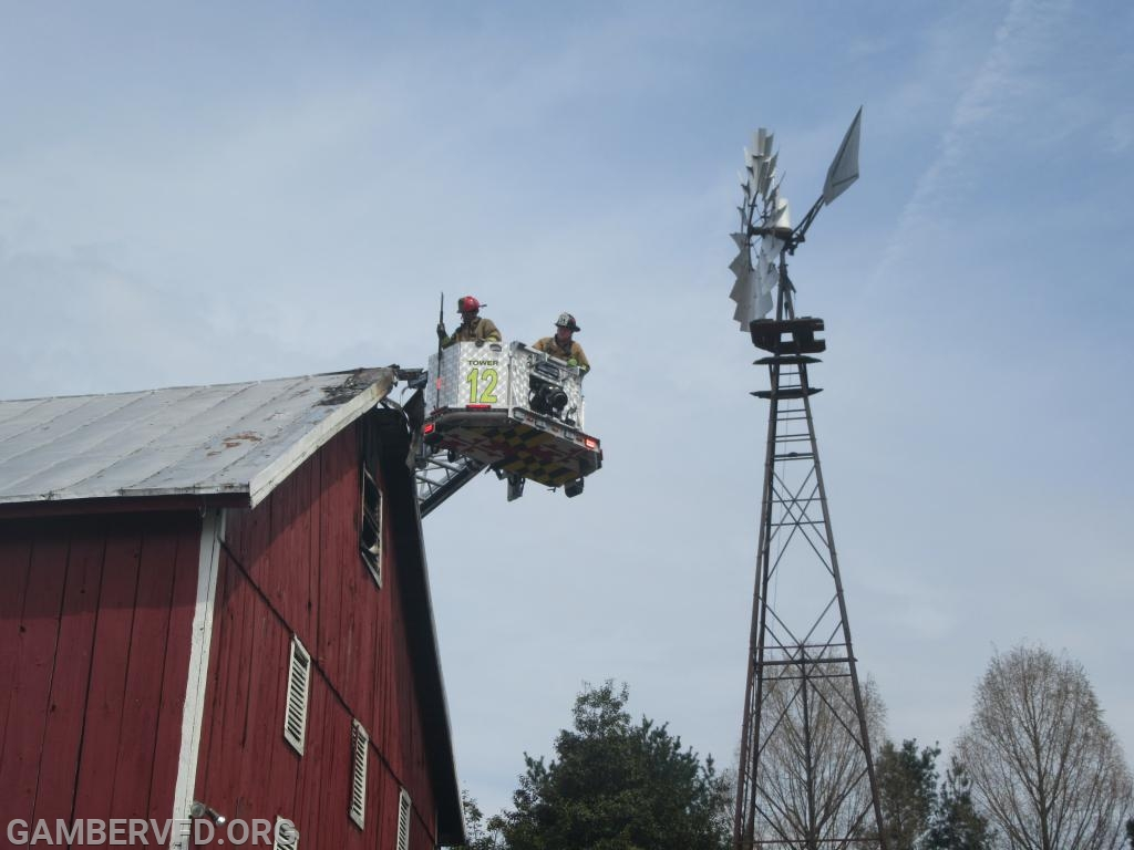 Sykesville's Tower 12 checks for fire in the large barn's roof.