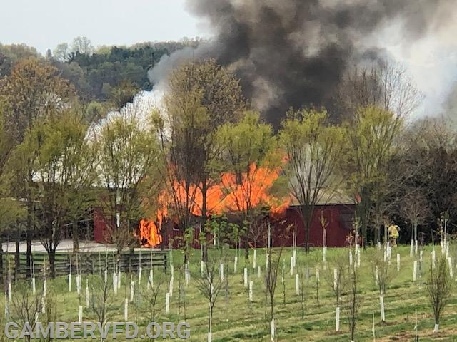 The barn fire prior to arrival of fire units. Photo by Randy Panos