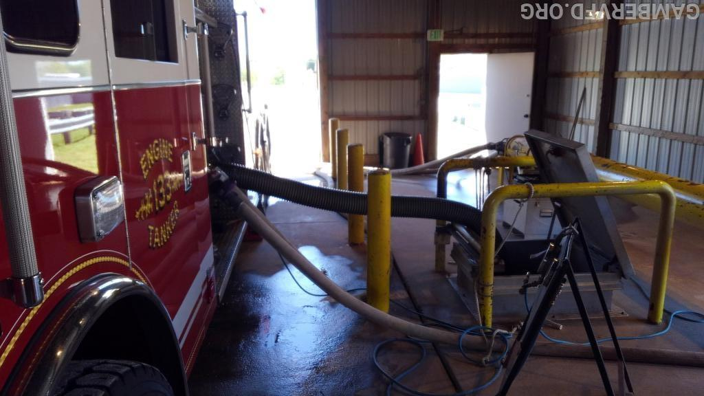 Engine/Tanker 133 hooked up for pump testing and drafting water from the underground tank.