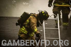 Firefighters working on the roof of a house fire on Oxwed Ct. Photo by Sean Baldwin