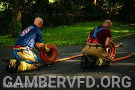 Members rolling hose after a working basement fire in Gamber's first due area. Photo by Sean Baldwin