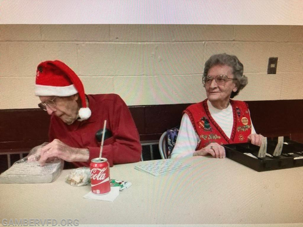 Charlie and Betty selling bingo games at the firehouse.
