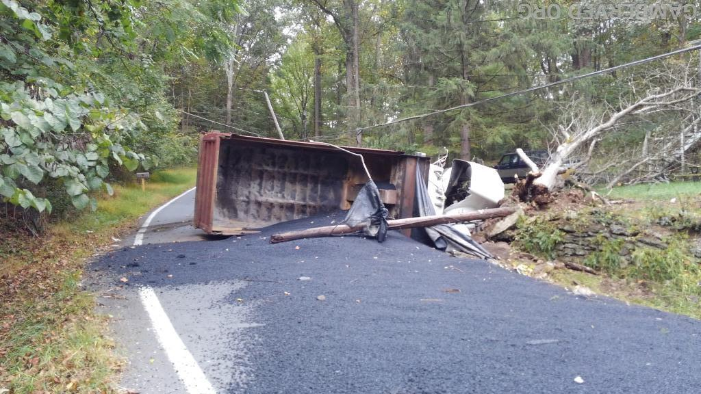 The truck's full load of hot asphalt spilled out on the roadway.