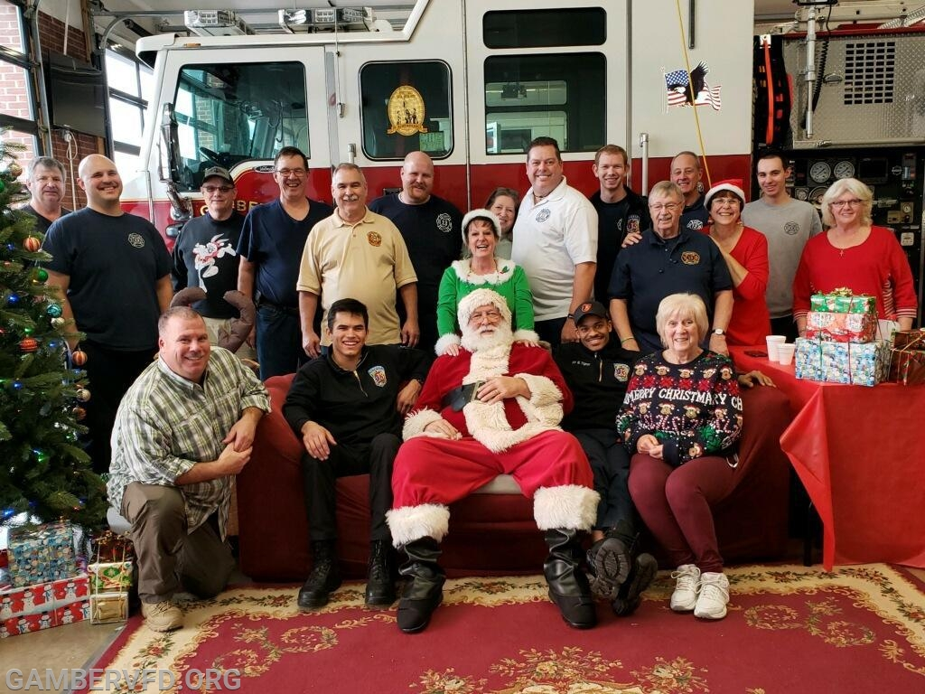 Santa and the volunteers.