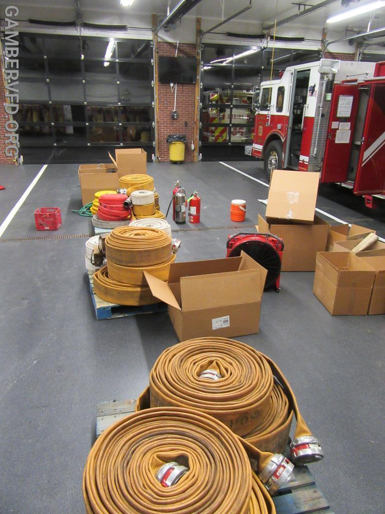 Rolled up hose from the engine's hose bed and additional tools and appliances.