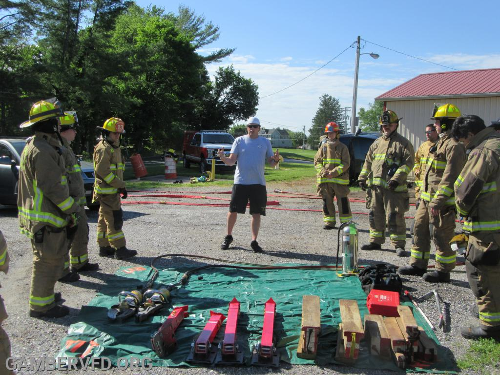 Assistant Chief Alan Barnes goes over some ground rules for the morning training and shows some of the devices and tools to be used.
