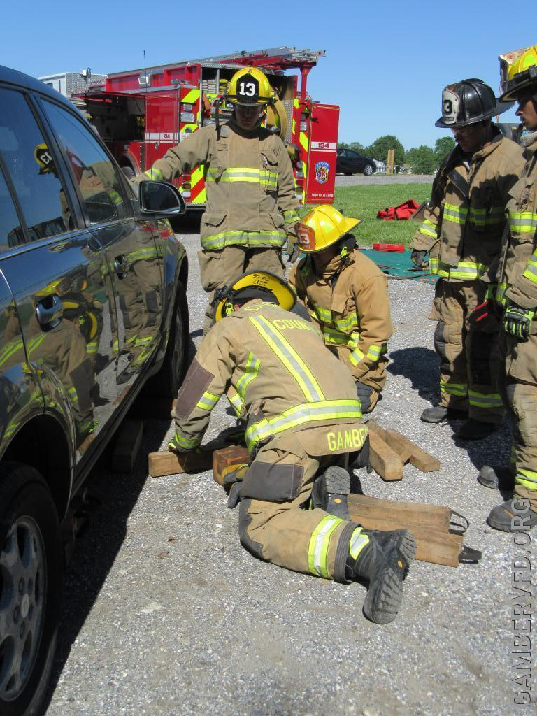 Stabilizing one of the vehicles to be used for training.