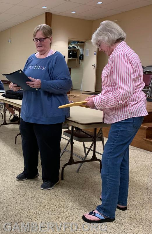 Jeannie Green (left) receives her plaque and citation from CCVESA Secretary Marianne Warehime on May 17, 2021 at Gamber's May company meeting.