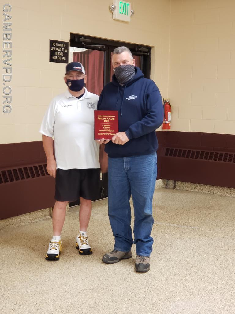 A special recognition award was presented to James Falise for his work installing and upgrading electrical service on the carnival grounds. President Dale Bollinger presented the award.