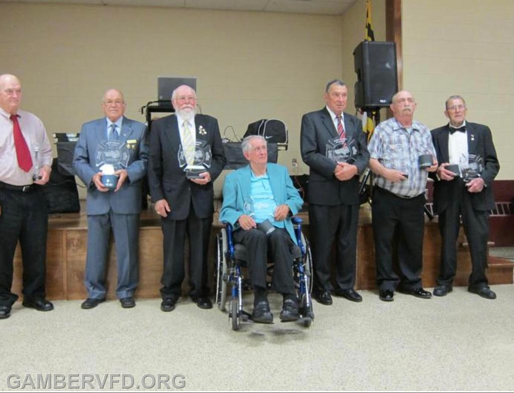 Buddy Lindsay (center) and other Gamber charter members were honored at the fire company's 50th Anniversary Banquet on May 10, 2014.