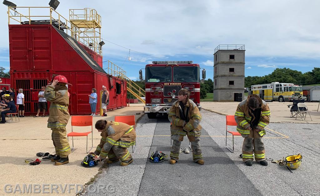 Juniors participate in donning turnout gear.
