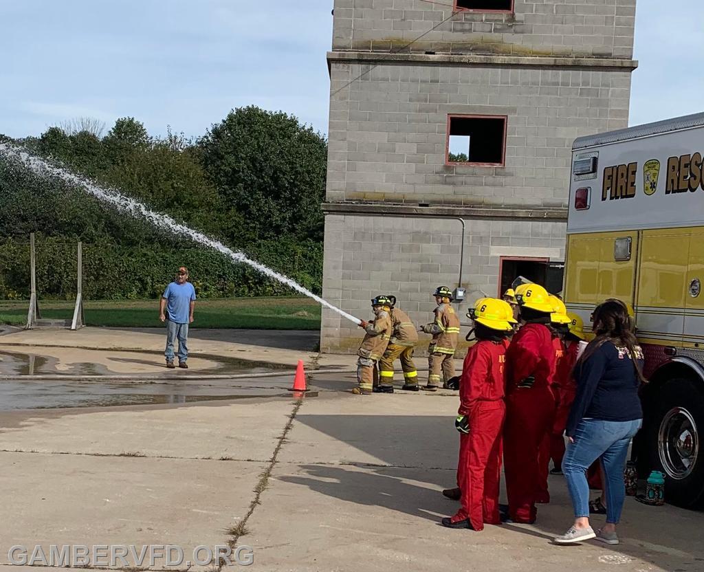 Juniors practice hose skills.