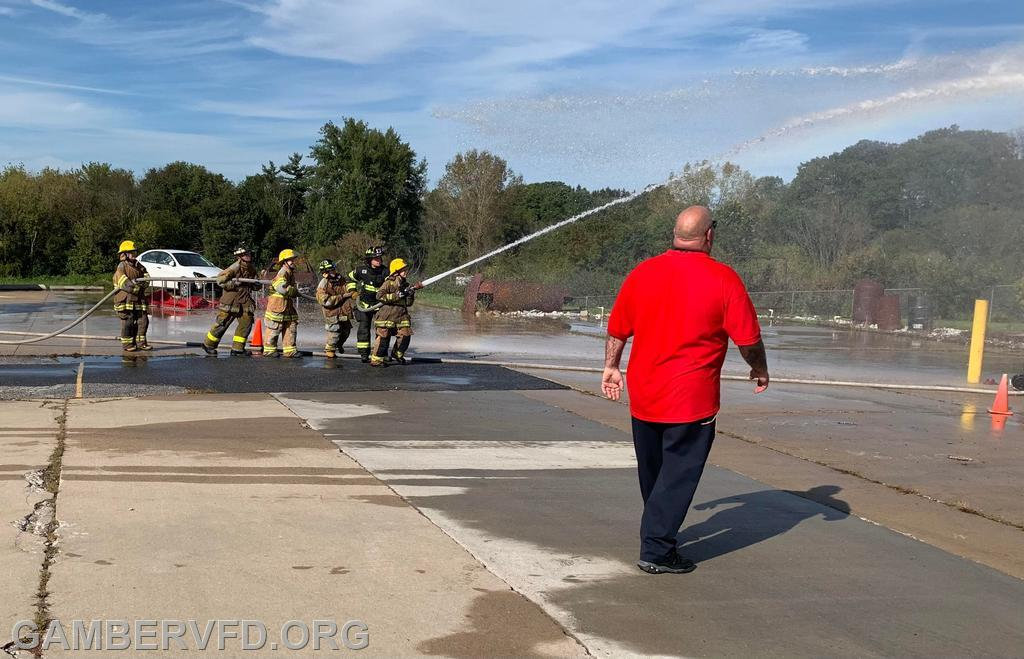 Juniors practice hose skills during the battle of the bucket.